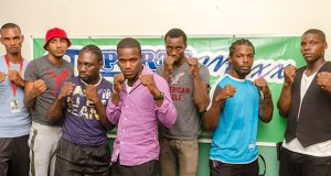 Some of the boxers, who will be on show at the GBBC's `Bad Intentions' card set for the Giftland Mall on August 27, strike a pose for photographer Delano Williams yesterday, after signing their respective contracts. Third right is Dexter Gonsalves who will fight American De Marcus `Chop Chop' Corley for the WBC FECABOX lightweight title.