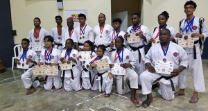 The winning karatekas display their prizes.