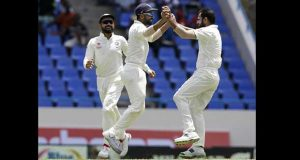 Mohammed Shami celebrates the wicket of Marlon Samuels. He went on to finish with  four for 66.