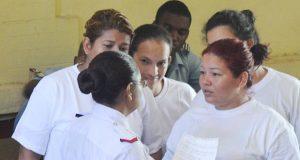 The Venezuelan female nationals speaking with their interpreter