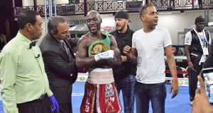GBBC's president Peter Abdool (second left) places the WBC's FECABOX lightweight title belt on USVI's Demarcus `Chop Chop) Corley after he defeated Guyana's Dexter Gonsalves for the title on Saturday evening at the Giftland Mall, ECD (Cullen Bess-Nelson photoS).
