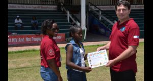 One of the children receives her certificate of participation