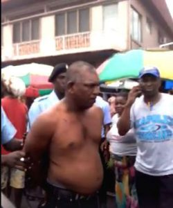 Man chops woman in public -receives sound thrashing from