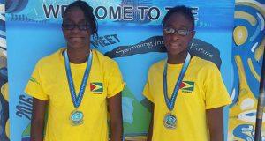 Twin sisters Jadyn and Danielle George at Goodwill Swim Meet
