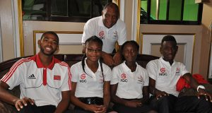 Seated from left: Trinidad's Ashton Gill, Shikyla Walcott, Joanna Rogers, and Recardo Prescott with manager Kelvin Nancoo in background, shortly after arriving in Guyana to compete in this weekend's Boyce/Jefford Classic VII.