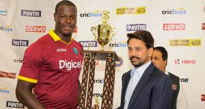 Carlos Brathwaite receives the winning  trophy from BCCI president , Anurag Thakur after the   the 2nd Paytm Twenty20 International between West Indies and India at Central Broward Stadium in Lauderhill, Florida was abandoned yesterday.(Photo by WICB Media/Randy Brooks of Brooks Latouche Photography)