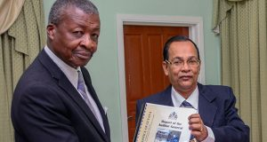 The Speaker of the National Assembly,Dr Barton Scotland, is seen receiving the 2015 Report on the Public Accounts from Auditor General Deodat Sharma (Samuel Maughn photo)