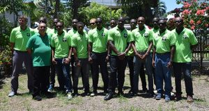The Green Machine, Guyana's rugby team pose for a picture before departing yesterday morning for the Cheddi Jagan International Airport.