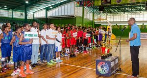 Director of Sport Christopher Jones addressing the teams at yesterday's opening ceremony.  (Delano Williams photos)