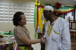 First Lady, Mrs. Sandra Granger shares a handshake with ACDA member, Mr. Egerton Cooke.