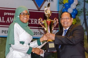 Fatima Karim of St. Rose's high, who gained 19 grade ones and one grade two, also received the Presidential Scholarship Award for CSEC from Prime Minister Moses Nagamootoo at the National Cultural Centre yesterday