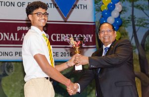 Presidential Scholarship Awardee Kayshav Tewari receives his award from Prime Minister Moses Nagamootoo, for being Guyana's Most Outstanding Performer-Overall at the National Award Ceremony for Outstanding Performance, hosted by the Ministry of Education at the National Cultural Centre (NCC) on Friday