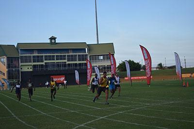 Linden's Compton Caesar taking the boys' U-20 100m win
