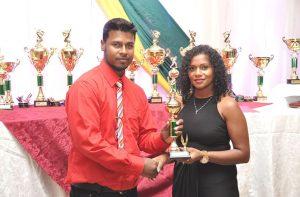 Rajkumar Budhram collects his MVP trophy.