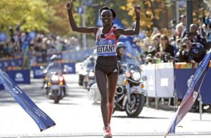 Mary Keitany of Kenya crosses the finish line to win the women's field of the 2016 New York City Marathon in Central Park in the Manhattan borough of New York City, New York. REUTERS/Mike Segar