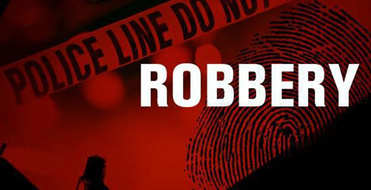 Bandits rob security guard