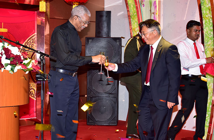 President David Granger And Chinese Ambador Mr Cui Jianchun Toast To The Friendly Relations Between Guyana China Motp Photo