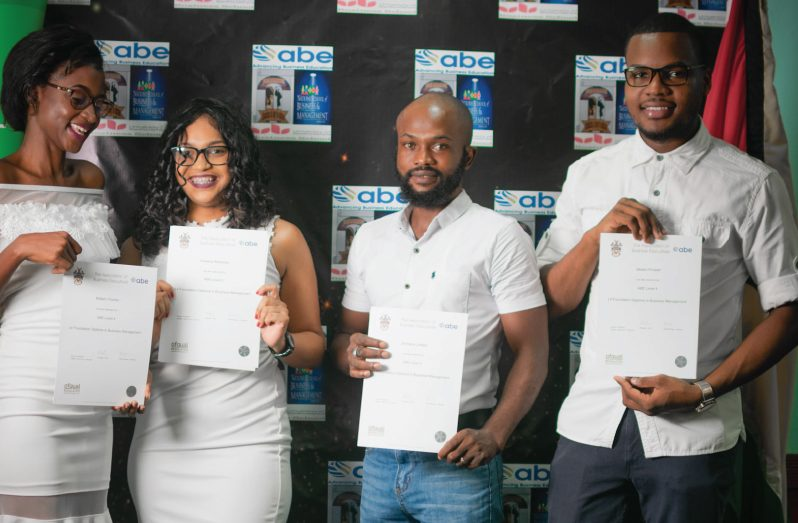 Four of the seven Barticans who completed their Level 4 foundation in Business management. From left: Noleen Charles, Ameena Rahaman, Jermaine Joseph and Akeem Prowell.