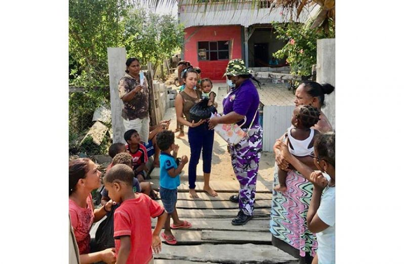 Activist and founder of United Bridge Builders Mission (UBBM), Bonita Montague distributing items to families in need