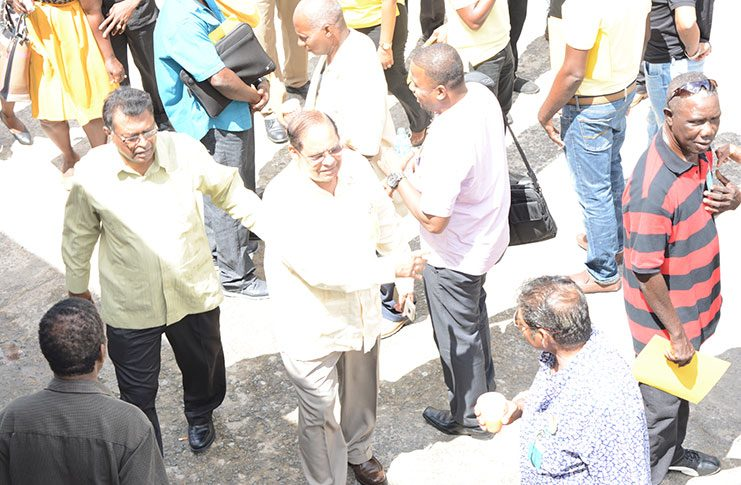 (From left) AFC top guns Khemraj Ramjattan and Moses Nagamootoo interact with supporters at the party's 5th Biennial National Congress at the Vreed-en-Hoop Primary School