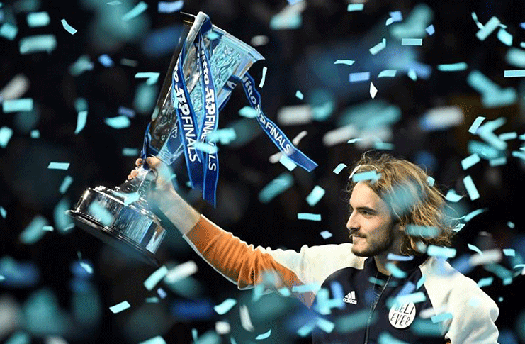 The O2, London, Britain -  Greece's Stefanos Tsitsipas celebrates winning the ATP Finals with the trophy REUTERS/Peter Nicholls