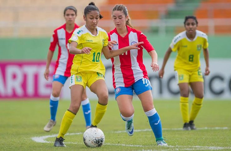Guyana's Kiana Khedoo (#10) battles Puerto Rico's Zoemi Cobián during the Lady Jags' 2–1 win in the CONCACAF U-20 Women's Championship, in Santo Domingo, Dominican Republic. (Photo compliments: Mexport/CONCACAF