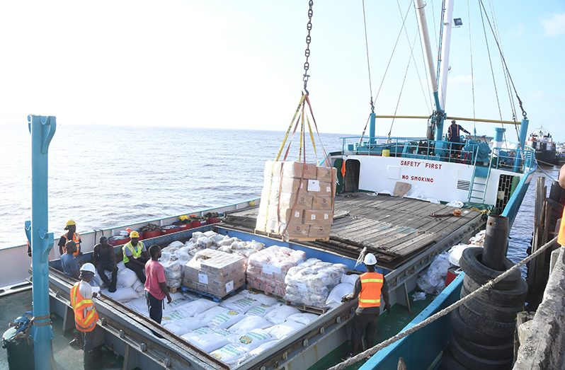 The third shipment of relief supplies destined for St. Vincent and the Grenadines and Barbados being loaded on to the motor vessel (MV) Lady Fazeela at  Muneshwer's Wharf, Georgetown, on Monday (Adrian Narine photo)