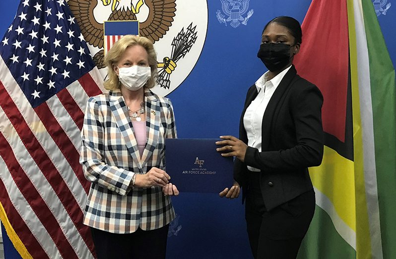 Ambassador Lynch congratulates Emmanuela Desir