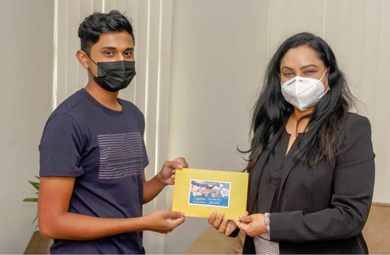 Minister Vindhya Persaud with second place winner, Robert Teekah