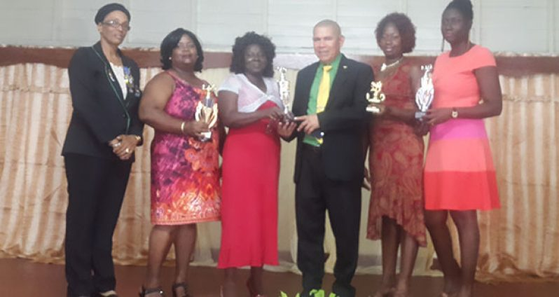 Public Health Minister Dr George Norton and Winner of the 2016 Gloria Noel Award, Kim Angus-Dennis, with  other awardees