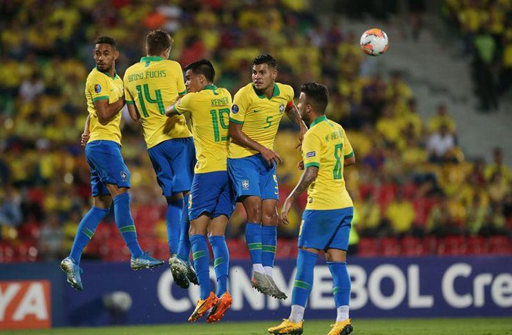 Brazil players in action during a defensive wall at Alfonso Lopez Stadium, Bucaramanga, Colombia (REUTERS/Luisa Gonzalez)