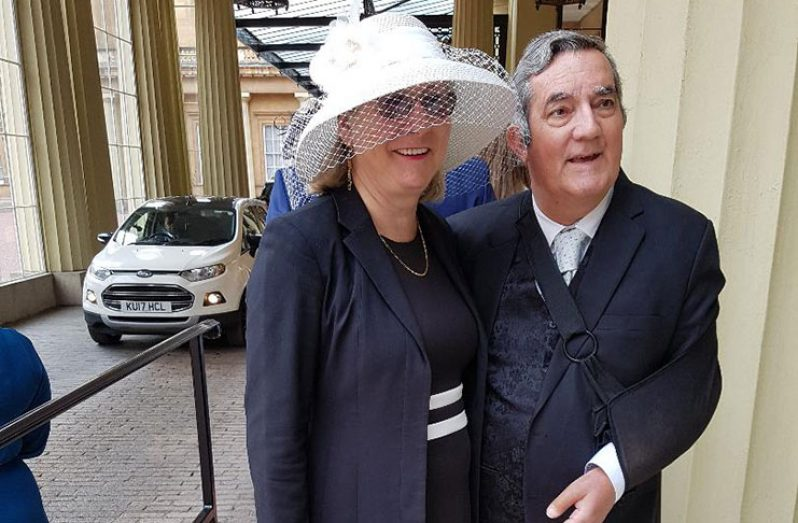 Dr. Brian O'Toole and his wife, Pamela O'Toole outside the Buckingham Palace