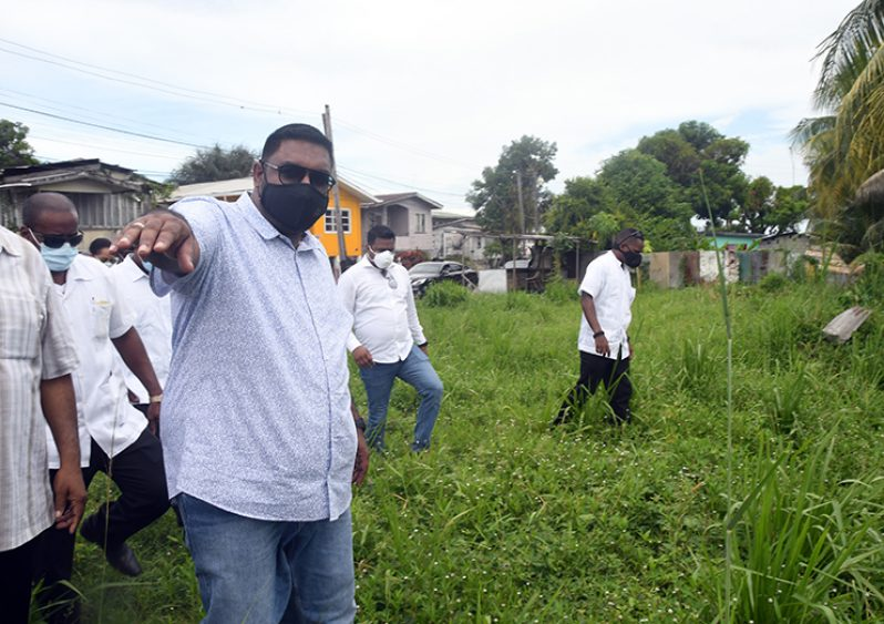 President, Dr. Irfaan Ali, inspects the site for the new Demerara Harbour Bridge (Adrian Narine photo)