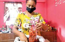 Beena Seenarine preparing snacks for her stand