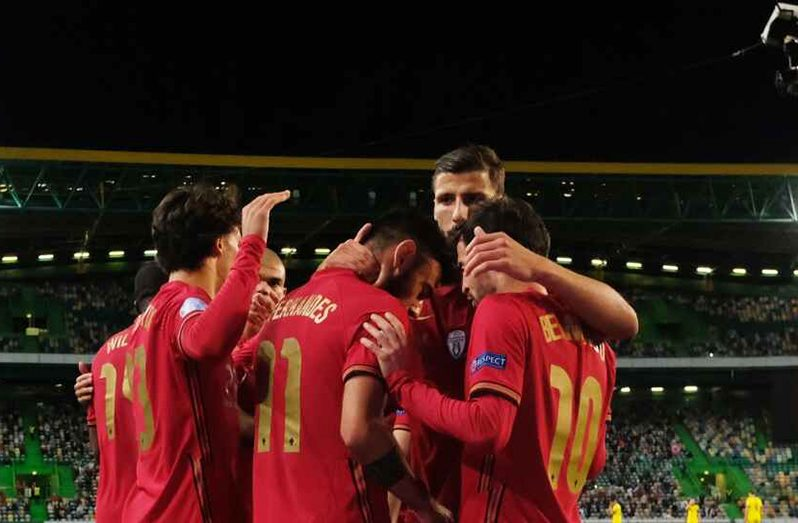 Portugal's Bernardo Silva celebrates scoring their first goal with teammates (Reuters)