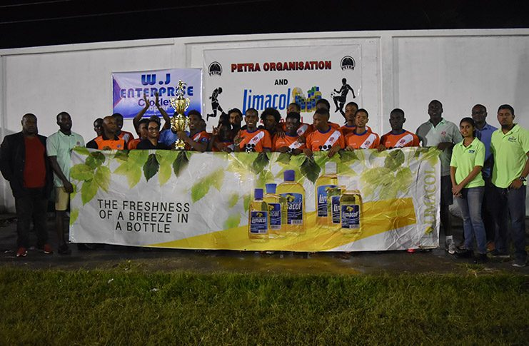 Fruta Conquerors celebrate with the Limacol after their 2-0 victory over  Santos FC on Sunday night.
