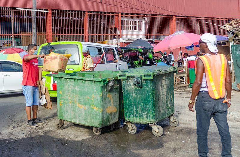 A citizen practising proper garbage disposal