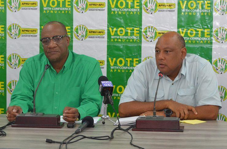 Campaign managers for the APNU+AFC Coalition, Joseph Harmon and Raphael Trotman