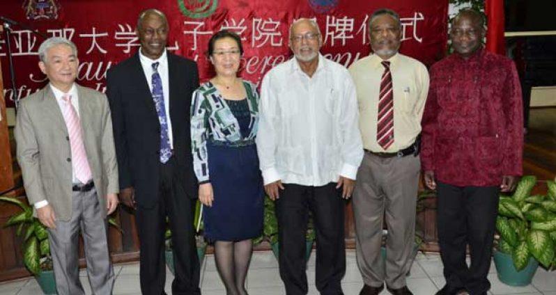 Chinese Ambassador Zhang Limin, Director, Professor Al Creighton, Prime Minister Samuel Hinds, President Donald Ramotar and UG's Vice Chancellor Jacob Opadeyi
