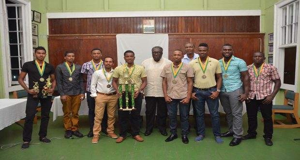 Members of the Hadi's world two-day tournament winners GCC standing with officials of the GCA and former West Indies Captain Clive Lloyd (Delano Williams Photo)