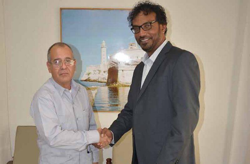 Ambassador Narciso Reinaldo Amador Socorro and GCSM President Halim Khan at the Cuban Embassy after their meeting