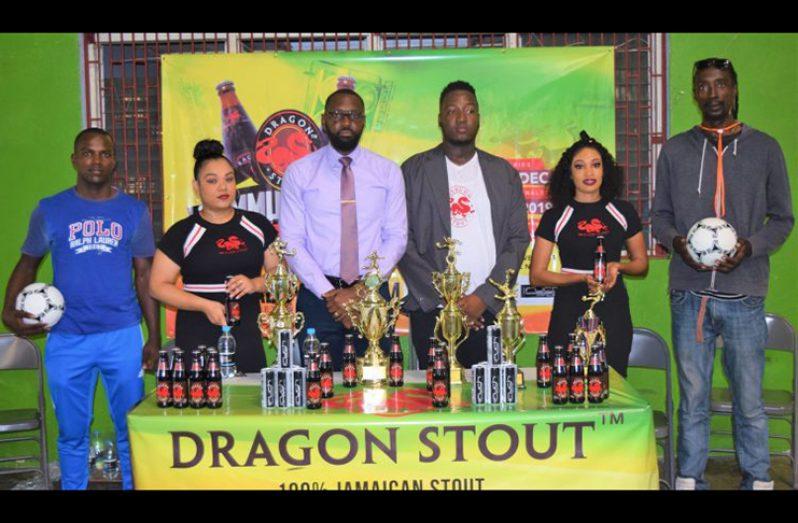 Director of Sport Christopher Jones (third left) and Dragon Stout Brand Coordinator, Jamal Baird, (third right) with Dragon Stout models and team representatives (Avenash Ramzan photo).