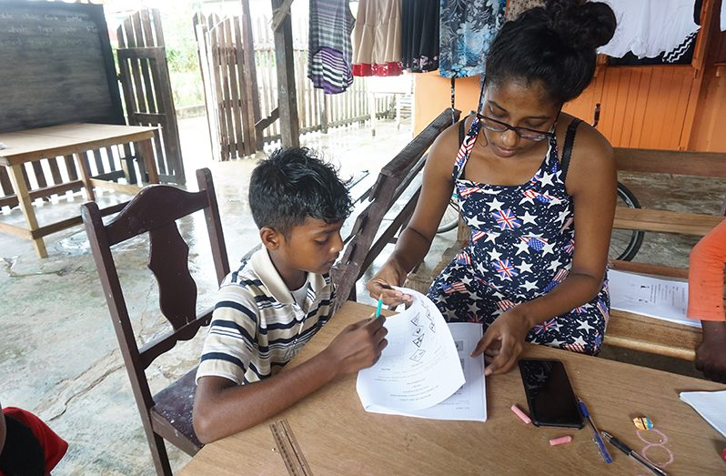Teacher Tarmila Bhawan home-schooling the children of her community (Carl Croker photos)
