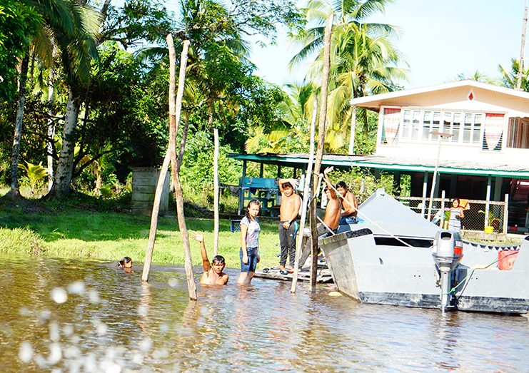 Residents having a cool bath in the Bonasika Creek (Carl Croker photos)