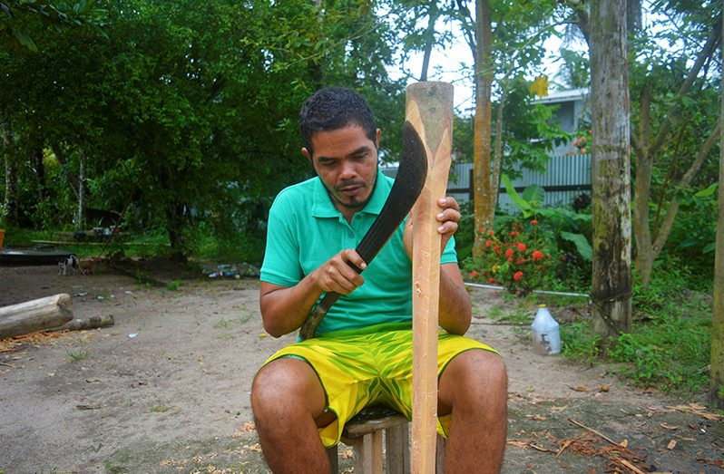 Alin Crighton as he was shaping the wood into an axe handle (Carl Croker photos)