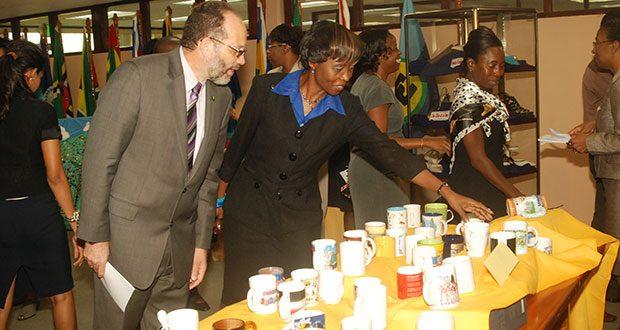 CARICOM Secretary-General, Ambassador, Irwin LaRocque, observing a display