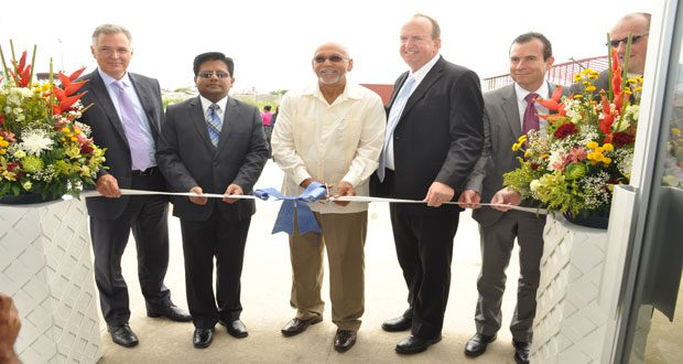 From left, Mr Kirk Laughlin, Finance Minister Dr. Ashni Singh, President Donald Ramotar, Qualfon's CEO (Guyana) Mr Mike Marrow and Qualfon's Founder and Chairman Mr Alfonso Gonzalez at the commissioning of the company's training  center at Providence yesterday (Delano Williams photo)