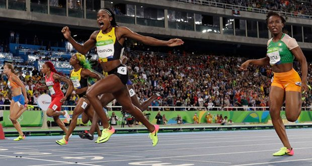 Jamaica's Elaine Thompson celebrates after winning gold in the women's 100-metre final