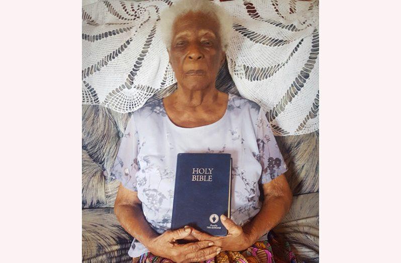 Lucretia Bradford holding her Holy Bible