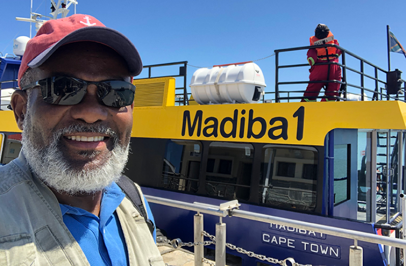 New York-based Guyanese journalist Hugh Hamiltonon the ferry to Robben Island last February, just before the COVID-19 struck.